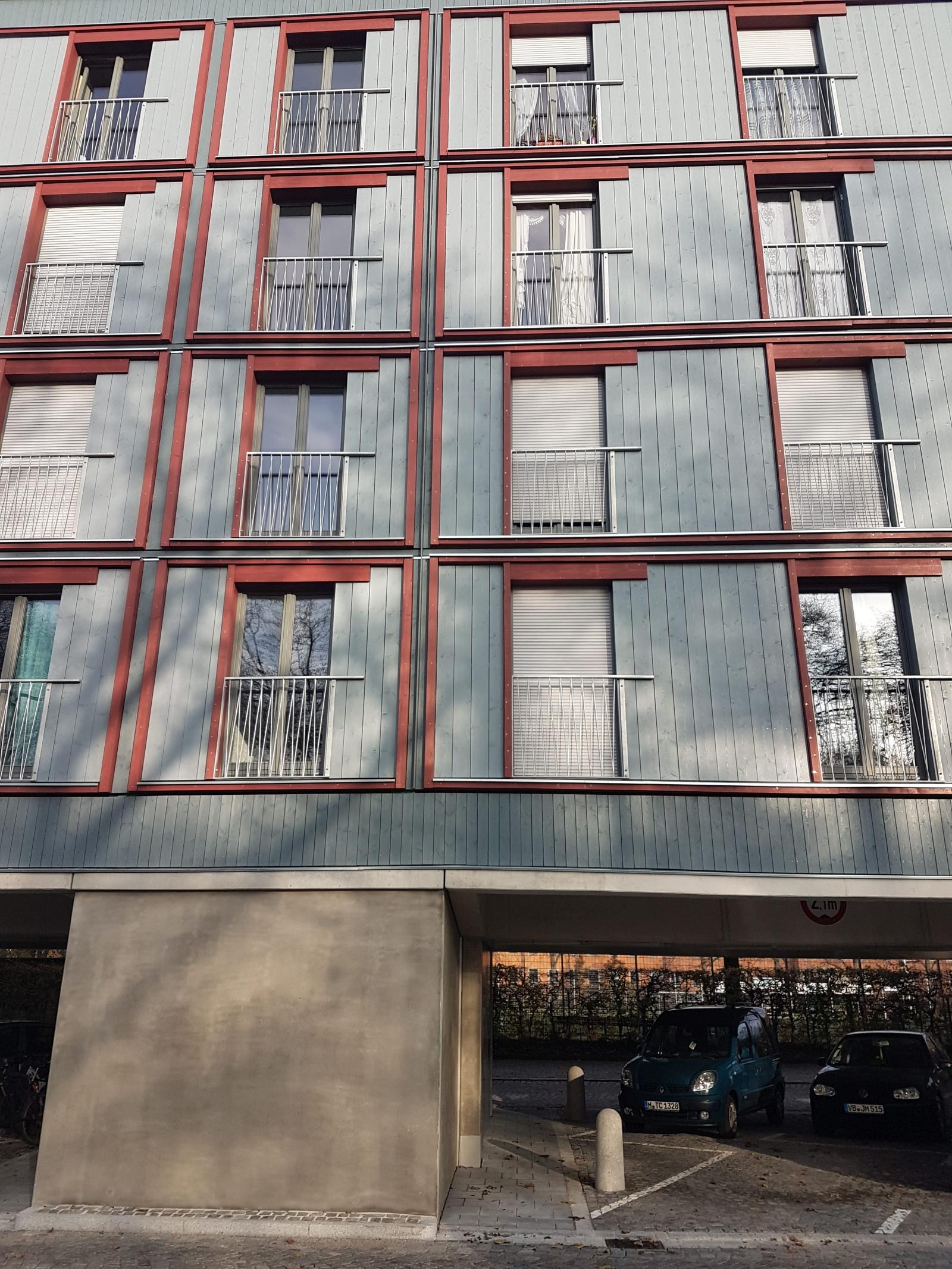 Dantebad München Überbauung Parkplatz bezahlbarer Wohnraum Holzsystembauweise